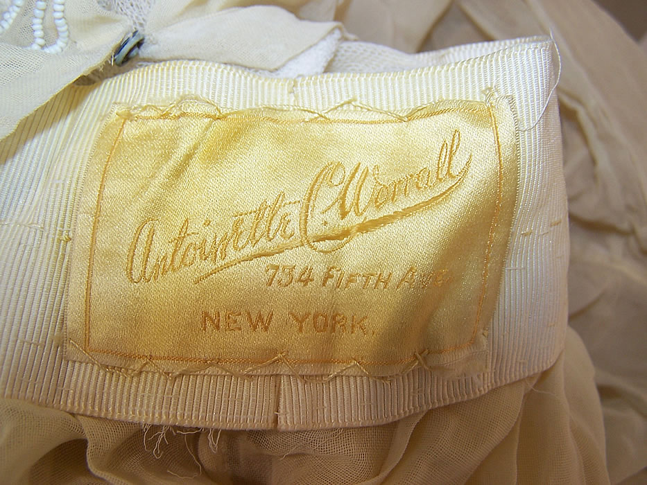 Edwardian Titanic Antoinette C. Worrall Yellow Muslin White Beaded Dress label close up.