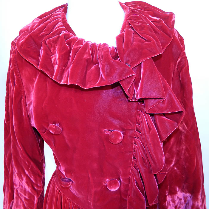Vintage Donald Brooks Red Velvet Ruffle Double Breasted Evening Dress Coat. The dress measures 37 inches long, with 36 inch hips, a 26 inch waist, 38 inch bust, 15 inch back and 22 inch long sleeves.