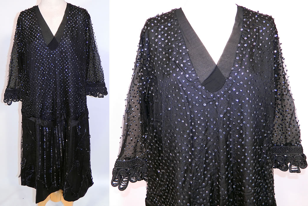 Vintage Black Silk Net Sequin Beaded Drop Waist Flapper Dress Large Size. This vintage Art Deco black silk net sequin beaded drop waist flapper dress dates from the 1920s. It is made of a black silk satin fabric underdress, with a sheer black net overlay and black sequin beading covering it.