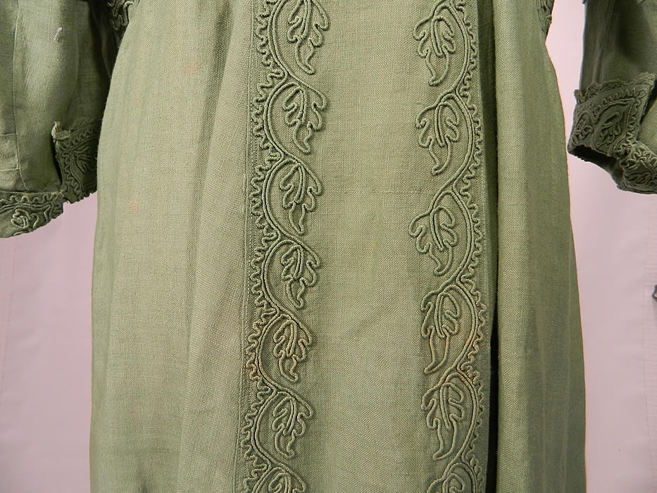 Edwardian Sage Green Linen Soutache Embroidered Grape Leaf Dress. The dress measures 56 inches long, with 36 inch hips, a 26 inch waist, 36 inch bust, 16 inch back and 16 inch long sleeves.