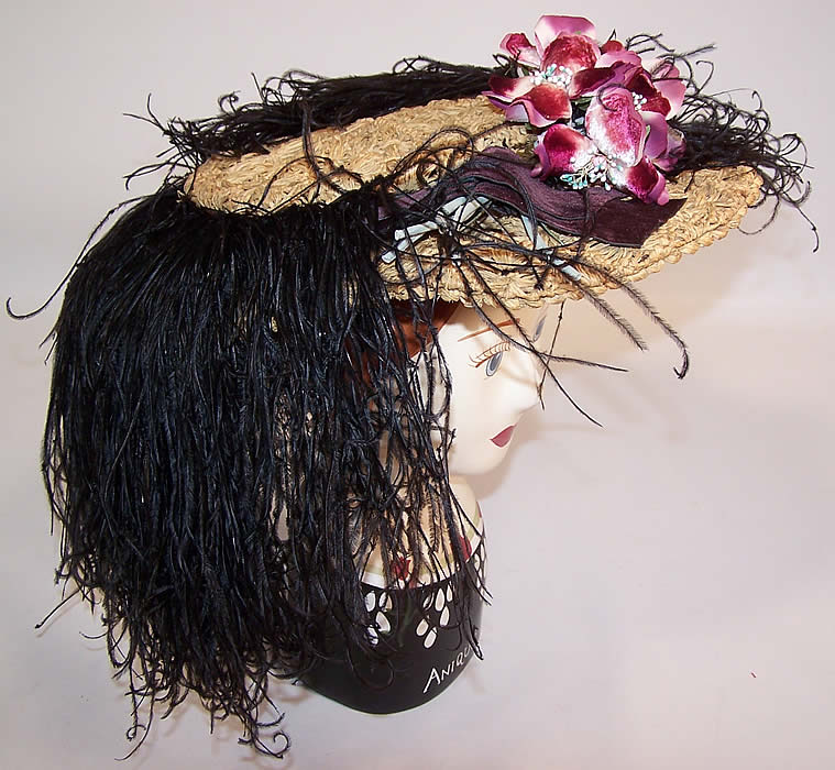 Belle Epoque Edwardian Natural Straw Raffia Wide Brim Ostrich Feather Hat side view.