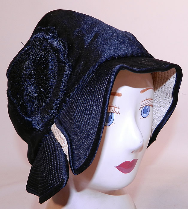 Vintage Marcelle Hats Art Deco Black  & White Silk Rosette Quilted Brim Flapper Cloche. This vintage Marcelle Hats Art Deco black and white silk rosette quilted brim flapper cloche dates from the 1920s.