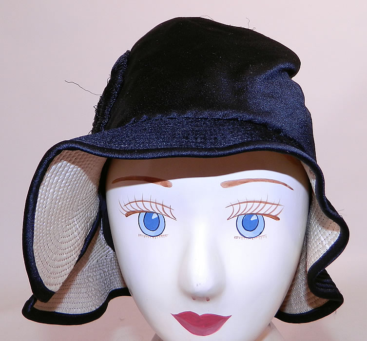 Vintage Marcelle Hats Art Deco Black  & White Silk Rosette Quilted Brim Flapper Cloche. The hat measures 22 inches inside crown circumference.