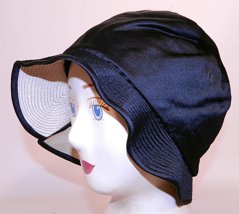 Vintage Marcelle Hats Art Deco Black  & White Silk Rosette Quilted Brim Flapper Cloche. This fabulous flapper cloche style hat has a form fitting style with an uneven wavy floppy brim.