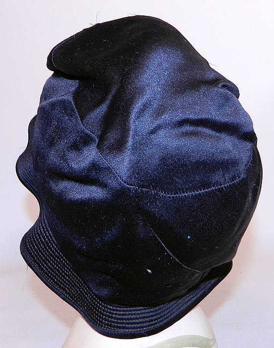 Vintage Marcelle Hats Art Deco Black  & White Silk Rosette Quilted Brim Flapper Cloche. It is in good condition, with three tiny pin holes on the bottom back (see close-up).