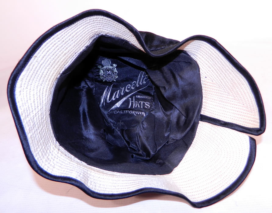 "Vintage Marcelle Hats Art Deco Black  & White Silk Rosette Quilted Brim Flapper Cloche. It is fully lined in silk and has a ""Marcelle Hats California"" label inside."