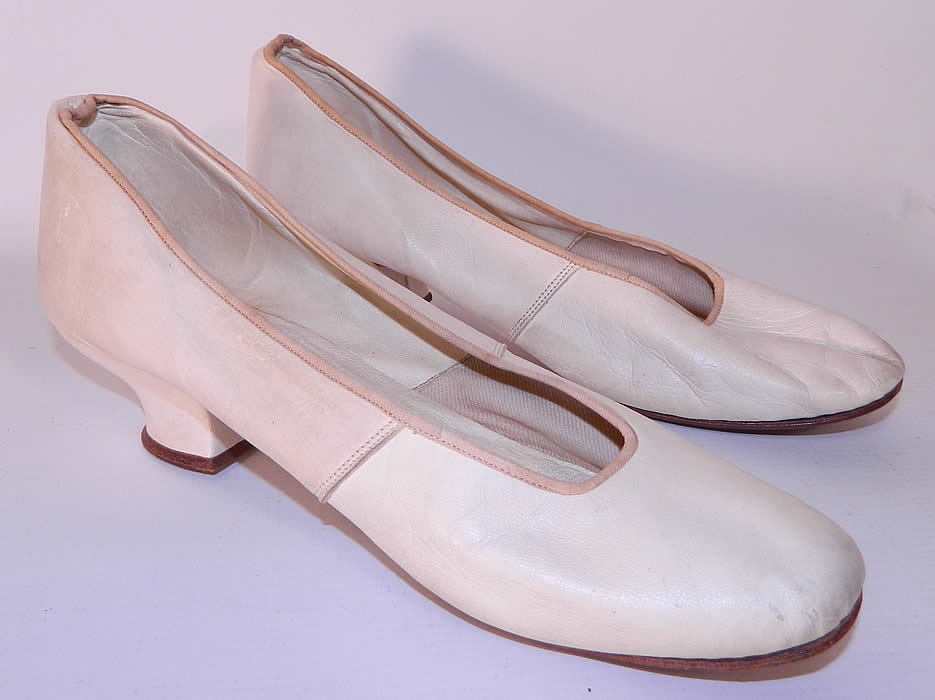 Victorian White Kid Leather Small Bridal Wedding Slippers Shoes Straight Sole. They are made of a soft supple white kid leather. These beautiful bridal slipper shoes have a slip on style, rounded toes, leather straight soles, with no left or right distinction and a 1 1/2 inch high kid covered Louis XV French heel.