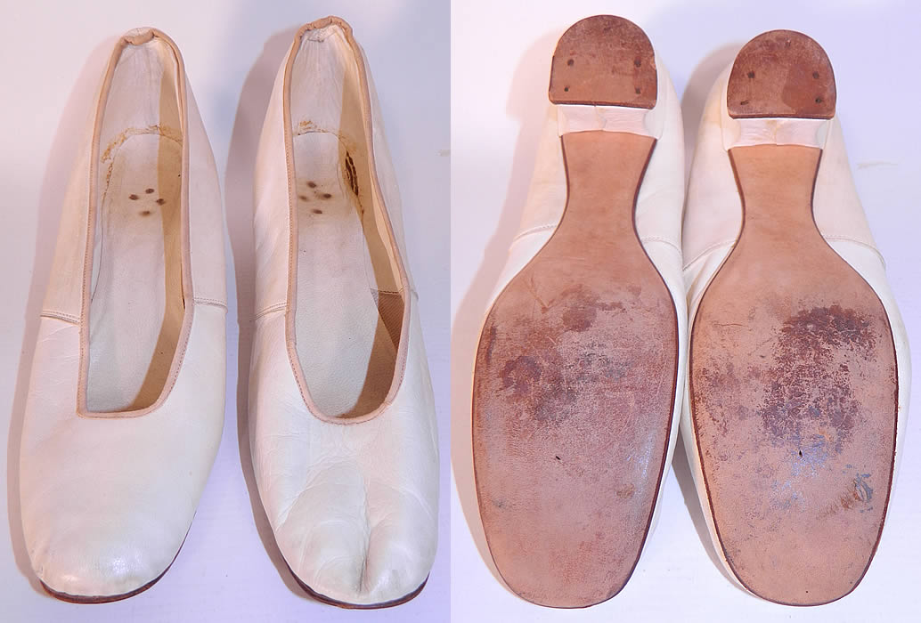 Victorian White Kid Leather Small Bridal Wedding Slippers Shoes Straight Sole. They are lined inside in white kid leather. The shoes are a small size measure 9 inches long and 2 1/4 inches wide.