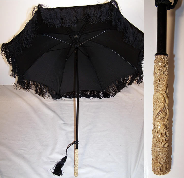 Victorian Black Silk Mourning Parasol Dragon Carved Handle close-up view.