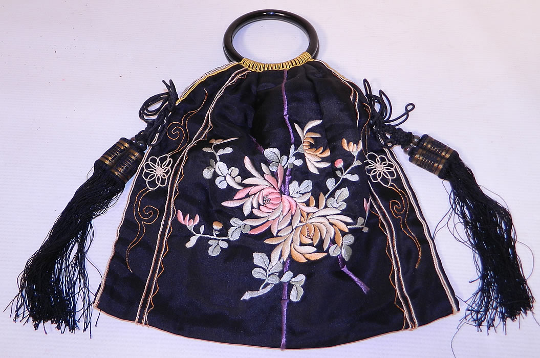 Antique Chinese Silk Embroidered Spider Chrysanthemum Tassel Purse. This antique Chinese silk embroidered spider chrysanthemum tassel purse dates from the 1920s. It is made of a black silk fabric, with colorful pastel silk raised padded satin stitch and gold metallic thread couching hand embroidery work.