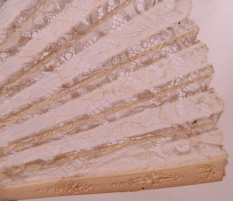 Antique Victorian Bridal Wedding White Bobbin Lace Pleated Folding Fan. This beautiful bridal wedding folding fan has a silver loop ring at the bottom holding the fan together, with a cream color silk ribbon for carrying.