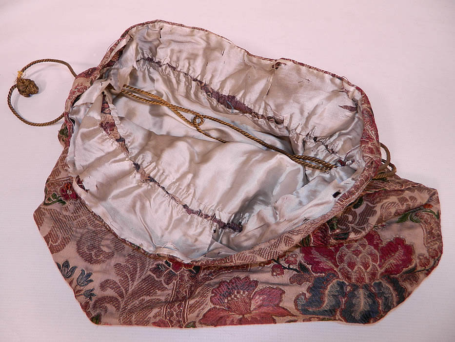 Victorian Antique  Silk Damask Brocade Jacobean Tapestry Fabric Bag Purse.It is in good condition, with some fraying on the inside silk lining. This is truly an amazing piece of antique textile art!